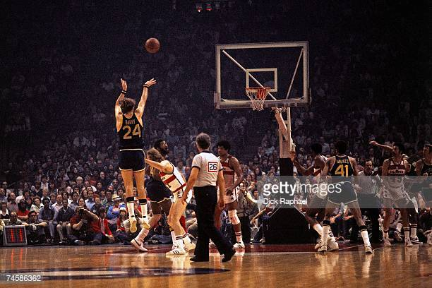 Rick Barry of the Golden State Warriors shoots a jump shot against the Washington Bullets during a 1975 NBA game at the Capital Centre in Washington...
