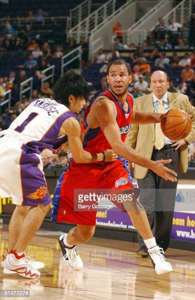 Rick Brunson of the Los Angeles Clippers drives against Yuta Tabuse of the Phoenix Suns on October 13 2004 at America West Arena in Phoenix Arizona...