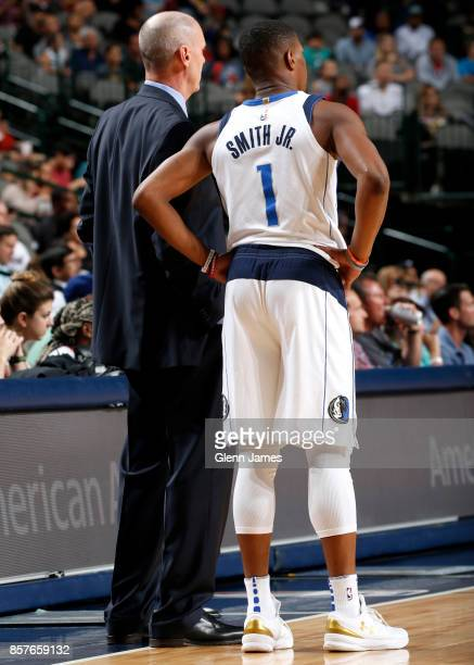 Rick Carlisle and Dennis Smith Jr #1 of the Dallas Mavericks talk during the game against the Chicago Bulls on October 4 2017 at the American...