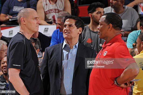 Rick Carlisle head coach and Mark Cuban owner of the Dallas Mavericks talk to Alvin Gentry of the New Orleans Pelicans before a Las Vegas Summer...