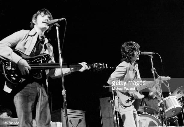 Rick Danko and Robbie Robertson of The Band perform at the Royal Albert Hall London 3rd June 1971 Rick Danko is playing an Ampeg fretless bass guitar