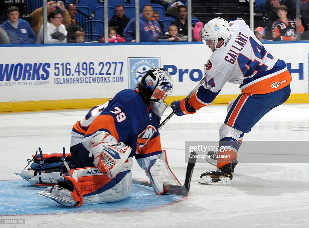Rick DiPietro #39 of Team Blue makes a save against Brett Gallant #44 of Team White during the shoot out portion of a scrimmage match between players of the New York Islanders and Bridgeport Sound Tigers on January 16, 2013 at Nassau Veterans Memorial Coliseum in Uniondale, New York.