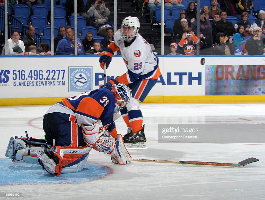 Rick DiPietro #39 of Team Blue makes a save against Brock Nelson #29 of Team White during the shoot out portion of a scrimmage match between players of the New York Islanders and Bridgeport Sound Tigers on January 16, 2013 at Nassau Veterans Memorial Coliseum in Uniondale, New York.