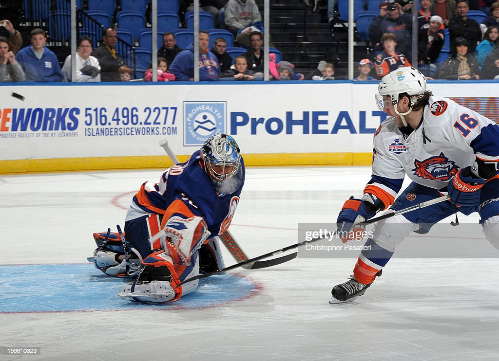 Rick DiPietro #39 of Team Blue makes a save against Sean Backman #16 of Team White during the shoot out portion of a scrimmage match between players of the New York Islanders and Bridgeport Sound Tigers on January 16, 2013 at Nassau Veterans Memorial Coliseum in Uniondale, New York.