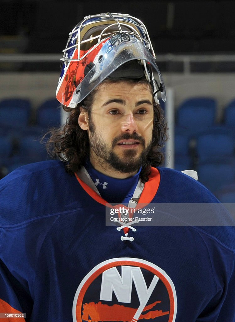 Rick DiPietro #39 of Team Blue skates off the ice after a scrimmage match between players of the New York Islanders and Bridgeport Sound Tigers on January 16, 2013 at Nassau Veterans Memorial Coliseum in Uniondale, New York.