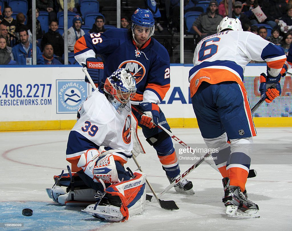 Rick DiPietro #39 of Team White deflects a shot on goal during a scrimmage match between players of the New York Islanders and Bridgeport Sound Tigers on January 16, 2013 at Nassau Veterans Memorial Coliseum in Uniondale, New York.