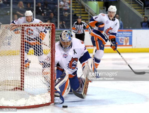 Rick DiPietro of the Bridgeport Sound Tigers makes a save during an American Hockey League game against the Adirondack Phantoms on March 2 2013 at...
