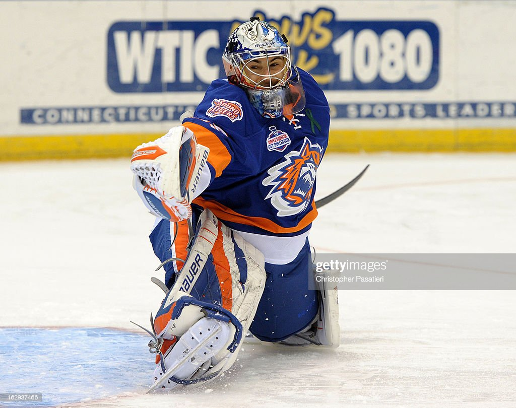 Rick DiPietro #39 of the Bridgeport Sound Tigers makes a save during warm ups against the Connecticut Whale on March 1, 2013 at the XL Center in Hartford, Connecticut.