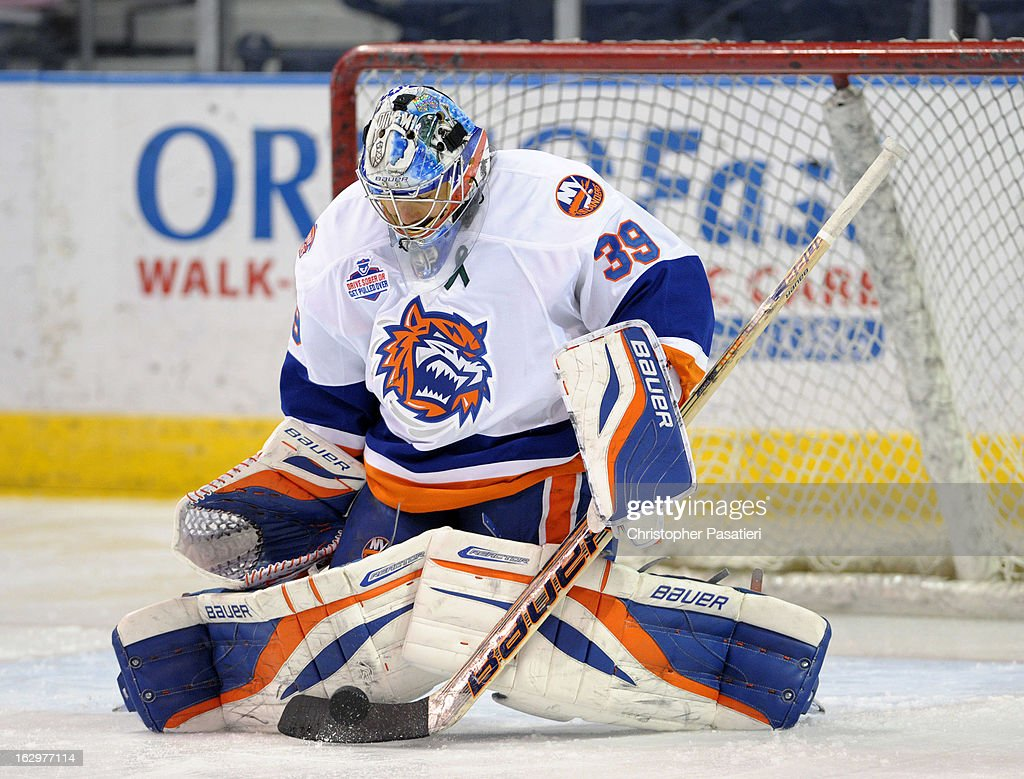 Rick DiPietro #39 of the Bridgeport Sound Tigers makes a save prior to an American Hockey League game against the Adirondack Phantoms on March 2, 2013 at the Webster Bank Arena at Harbor Yard in Bridgeport, Connecticut.