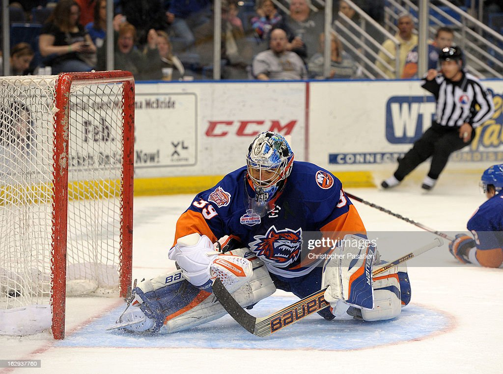 <a gi-track='captionPersonalityLinkClicked' href=/galleries/search?phrase=Rick+DiPietro&family=editorial&specificpeople=201931 ng-click='$event.stopPropagation()'>Rick DiPietro</a> #39 of the Bridgeport Sound Tigers reacts after allowing one of five goals during the first period of an American Hockey League game against the Connecticut Whale on March 1, 2013 at the XL Center in Hartford, Connecticut.