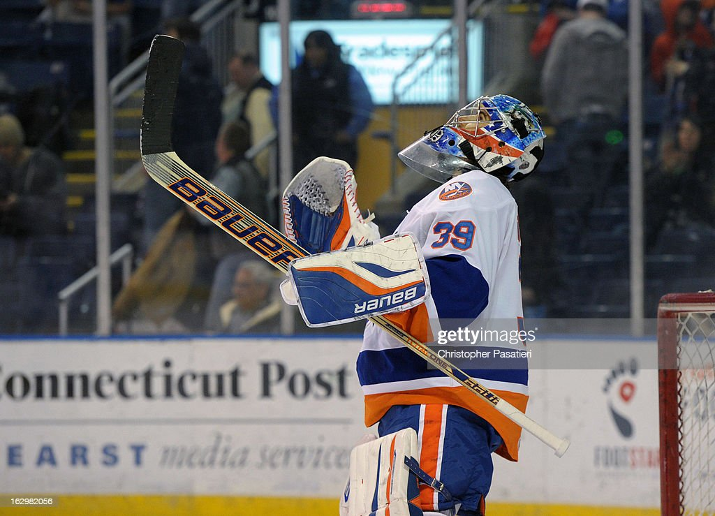 Rick DiPietro #39 of the Bridgeport Sound Tigers reacts after defeating the Adirondack Phantoms during an American Hockey League on March 2, 2013 at the Webster Bank Arena at Harbor Yard in Bridgeport, Connecticut.