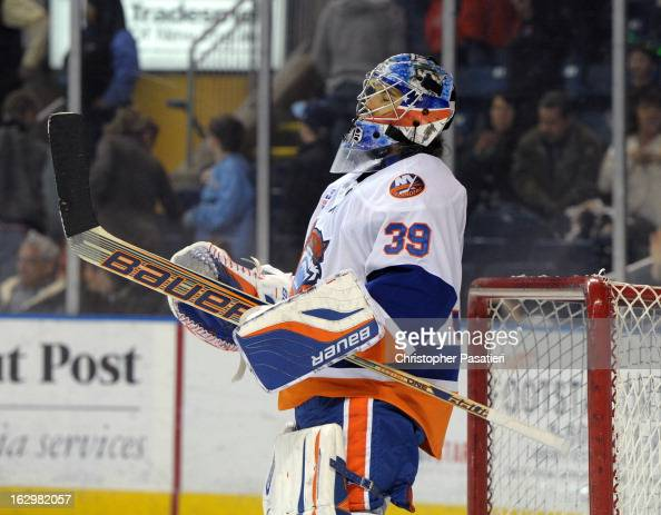 Rick DiPietro of the Bridgeport Sound Tigers reacts after defeating the Adirondack Phantoms during an American Hockey League on March 2 2013 at the...