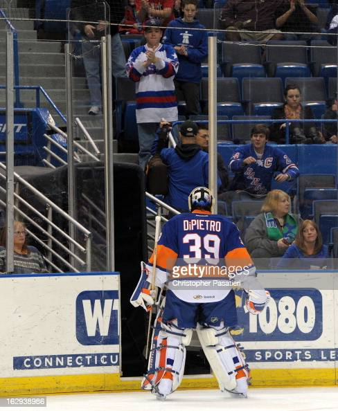 Rick DiPietro of the Bridgeport Sound Tigers skates off the ice after allowing five goals in the first period of an American Hockey League game...