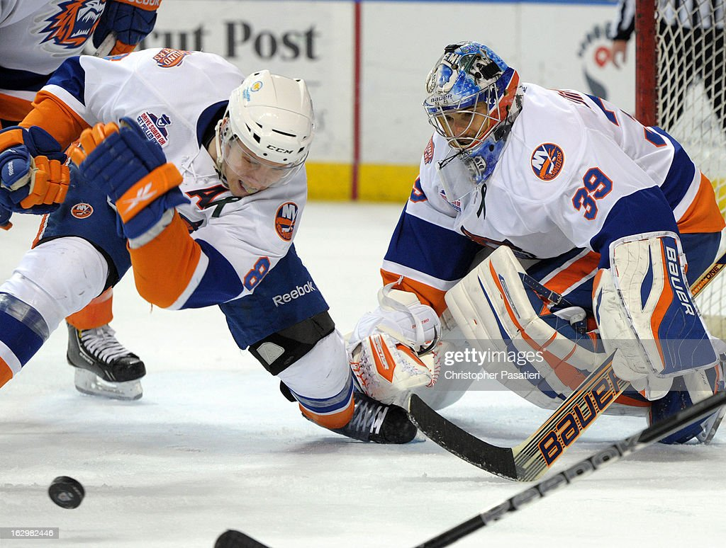 <a gi-track='captionPersonalityLinkClicked' href=/galleries/search?phrase=Rick+DiPietro&family=editorial&specificpeople=201931 ng-click='$event.stopPropagation()'>Rick DiPietro</a> #39 of the Bridgeport Sound Tigers watches as Nathan McIver #8 clears the puck from the front of the net during an American Hockey League game against the Adirondack Phantoms on March 2, 2013 at the Webster Bank Arena at Harbor Yard in Bridgeport, Connecticut.