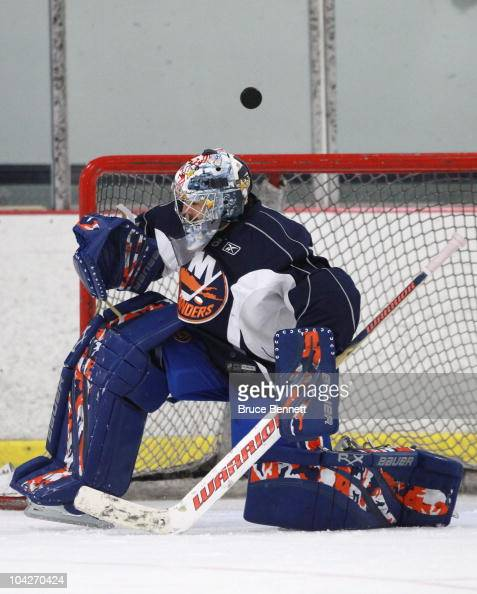 Rick DiPietro of the New York Islanders bobbles a shot during a training camp session at Iceworks on September 19 2010 in Syosset New York