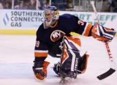 Rick DiPietro of the New York Islanders defends his goal against the New Jersey Devils during their NHL preseason game on September 30 2006 at the...