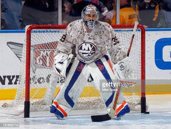 Rick DiPietro of the New York Islanders defends the net during warmups wearing a commemortive jersey for Military Appreciation Night prior to the...