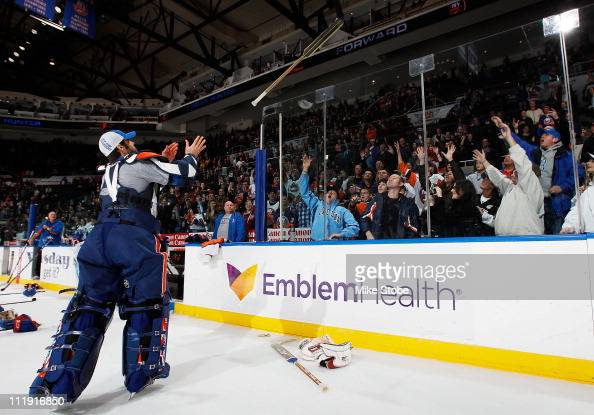 Rick DiPietro of the New York Islanders gives his stick away to fans after the last home game of the 20102011 season against the Pittsburgh Penguins...