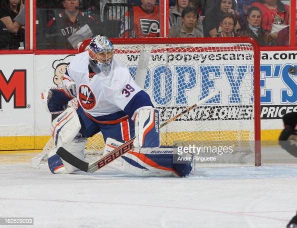 Rick DiPietro of the New York Islanders guards his net against the Ottawa Senators on February 19 2013 at Scotiabank Place in Ottawa Ontario Canada