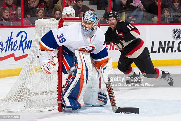 Rick DiPietro of the New York Islanders guards his net during an NHL game against the Ottawa Senators at Scotiabank Place on February 19 2013 in...