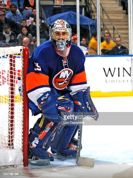 Rick Dipietro of the New York Islanders in action during a game against the New Jersey Devils at Nassau Veterans Memorial Coliseum on October 2 2010...