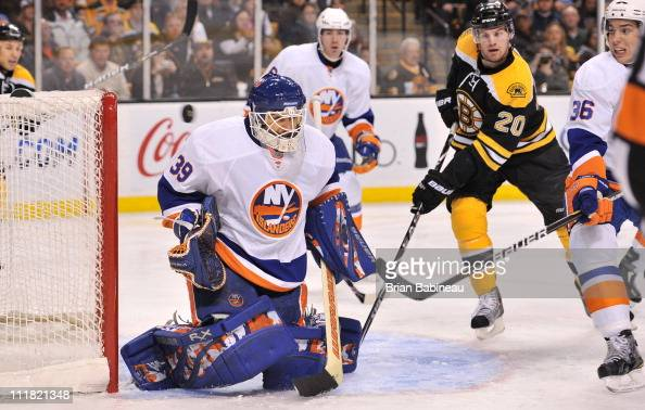 Rick DiPietro of the New York Islanders just misses the puck against the Boston Bruins at the TD Garden on April 6 2011 in Boston Massachusetts