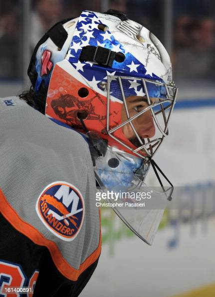 Rick DiPietro of the New York Islanders looks on prior to the game against the New Jersey Devils on February 3 2013 at Nassau Veterans Memorial...