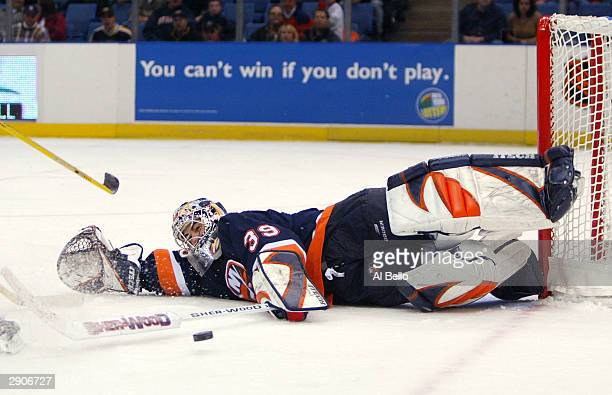 Rick DiPietro of the New York Islanders makes a save against the Boston Bruins January 27 2004 at the Nassau Coliseum in Uniondale New York
