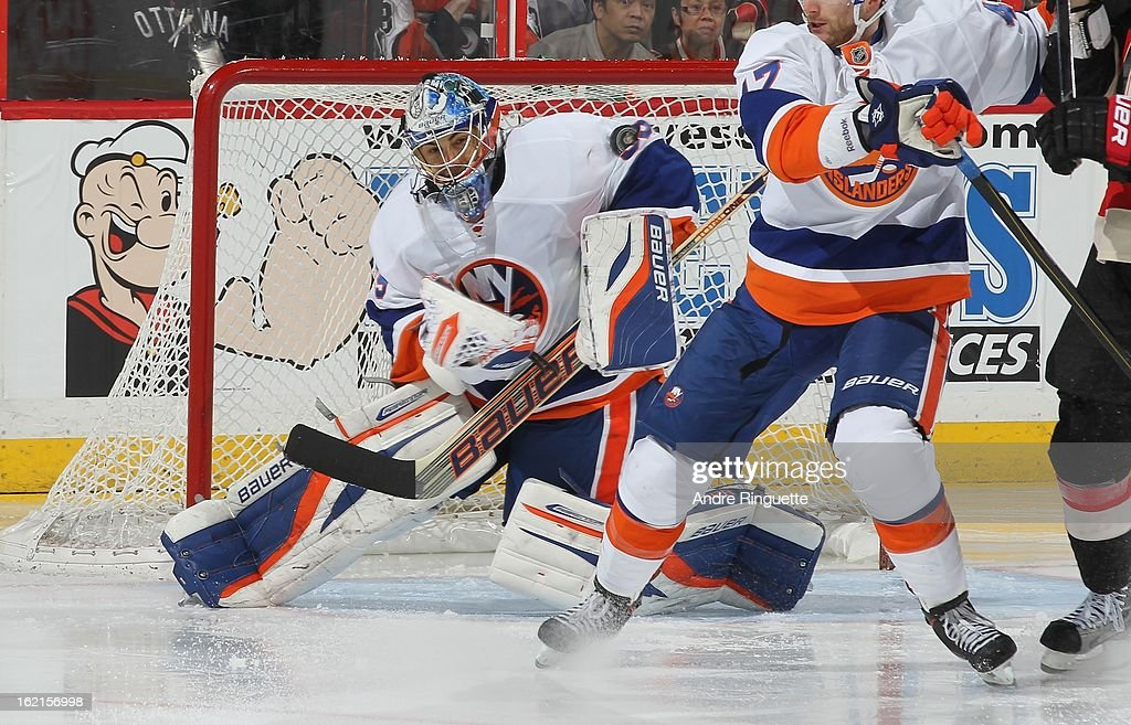 Rick DiPietro #39 of the New York Islanders makes a shoulder save against the Ottawa Senators on February 19, 2013 at Scotiabank Place in Ottawa, Ontario, Canada.
