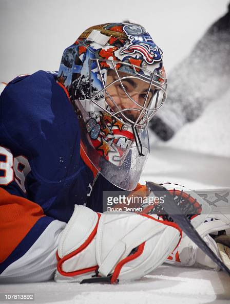 Rick DiPietro of the New York Islanders makes the stop against the Pittsburgh Penguins at the Nassau Coliseum on December 29 2010 in Uniondale New...