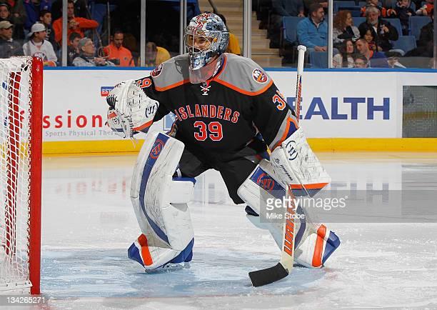 Rick DiPietro of the New York Islanders skates against the Philadelphia Flyers at Nassau Veterans Memorial Coliseum on November 23 2011 in Uniondale...