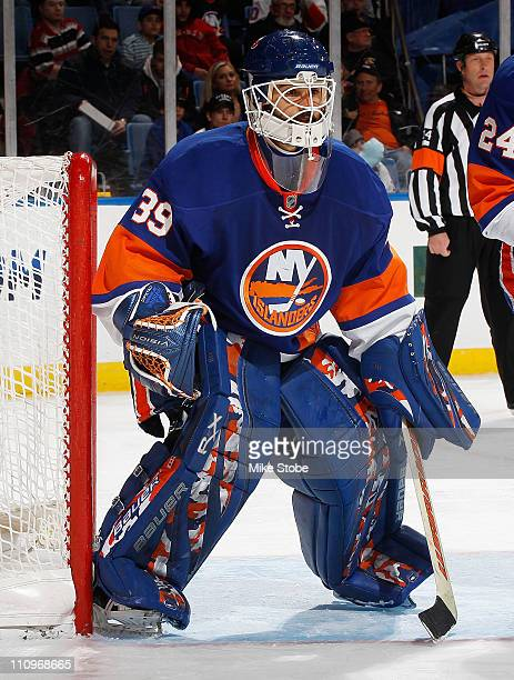 Rick DiPietro of the New York Islanders skates against the Philadelphia Flyers on March 26 2011 at Nassau Coliseum in Uniondale New York Flyers...
