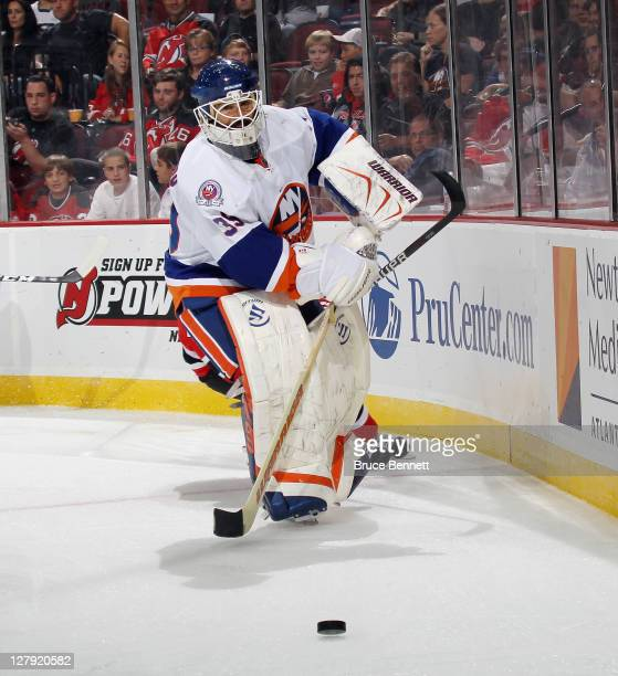 Rick DiPietro of the New York Islanders skates against the New Jersey Devils at the Prudential Center on September 30 2011 in Newark New Jersey The...
