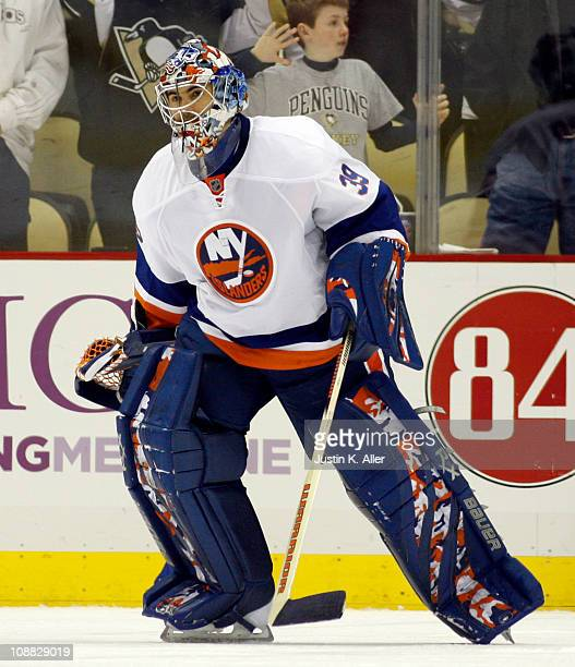 Rick DiPietro of the New York Islanders skates against the Pittsburgh Penguins at Consol Energy Center on February 2 2011 in Pittsburgh Pennsylvania...