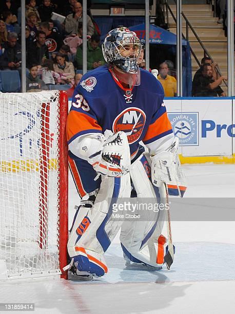 Rick DiPietro of the New York Islanders skates against the Washington Capitals at Nassau Veterans Memorial Coliseum on November 5 2011 in Uniondale...