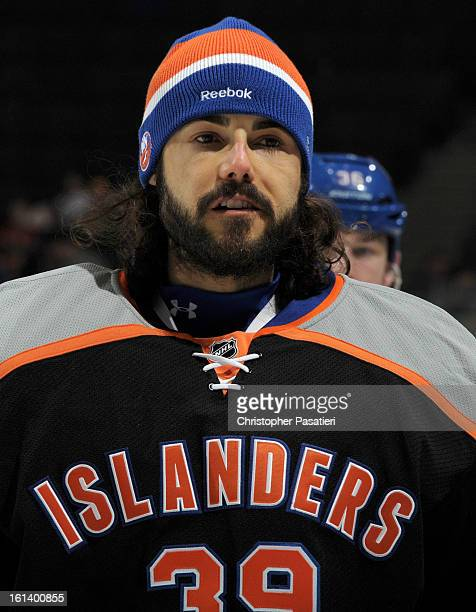 Rick DiPietro of the New York Islanders skates off the ice after the game against the New Jersey Devils on February 3 2013 at Nassau Veterans...