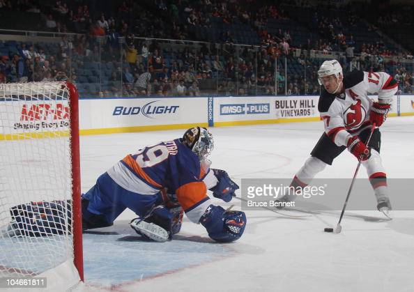 Rick DiPietro of the New York Islanders stops Ilya Kovalchuk of the New Jersey Devils on a penalty shot at the Nassau Veterans Memorial Coliseum on...