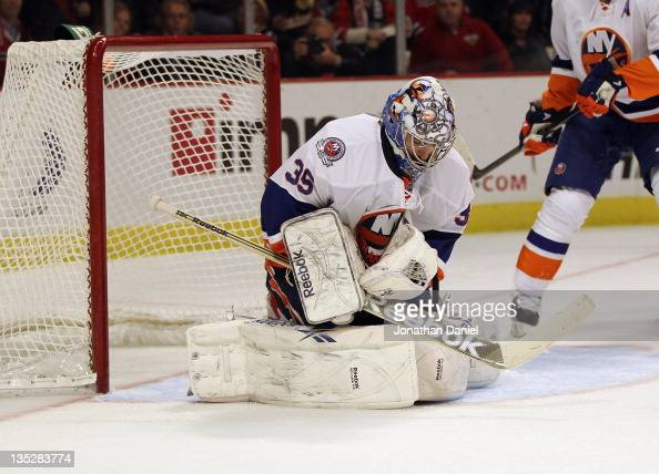 Rick DiPietro of the New York Islanders stops the puck against the Chicago Blackhawks at the United Center on December 2 2011 in Chicago Illinois The...
