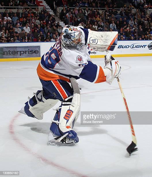 Rick DiPietro of the New York Islanders tends net against the Boston Bruins at the Nassau Veterans Memorial Coliseum on November 19 2011 in Uniondale...