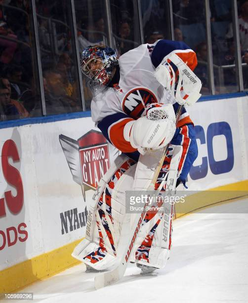Rick DiPietro of the New York Islanders tends net against the New York Rangers at the Nassau Coliseum on October 11 2010 in Uniondale New York