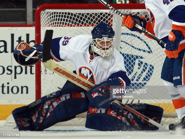 Rick DiPietro of the New York Islanders tends net against the New Jersey Devils at the Prudential Center on March 30 2011 in Newark New Jersey The...
