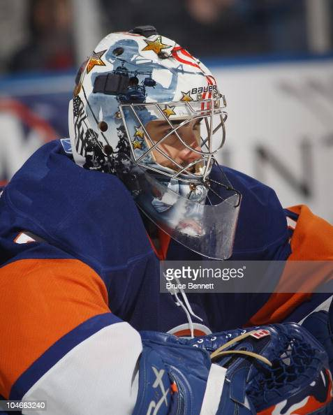 Rick DiPietro of the New York Islanders waits for a faceoff in his game against the New Jersey Devils at the Nassau Veterans Memorial Coliseum on...