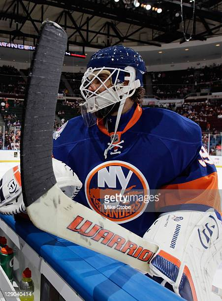 Rick DiPietro of the New York Islanders warms up prior to the start of the game against the Florida Panthers on October 8 2011 at Nassau Coliseum in...