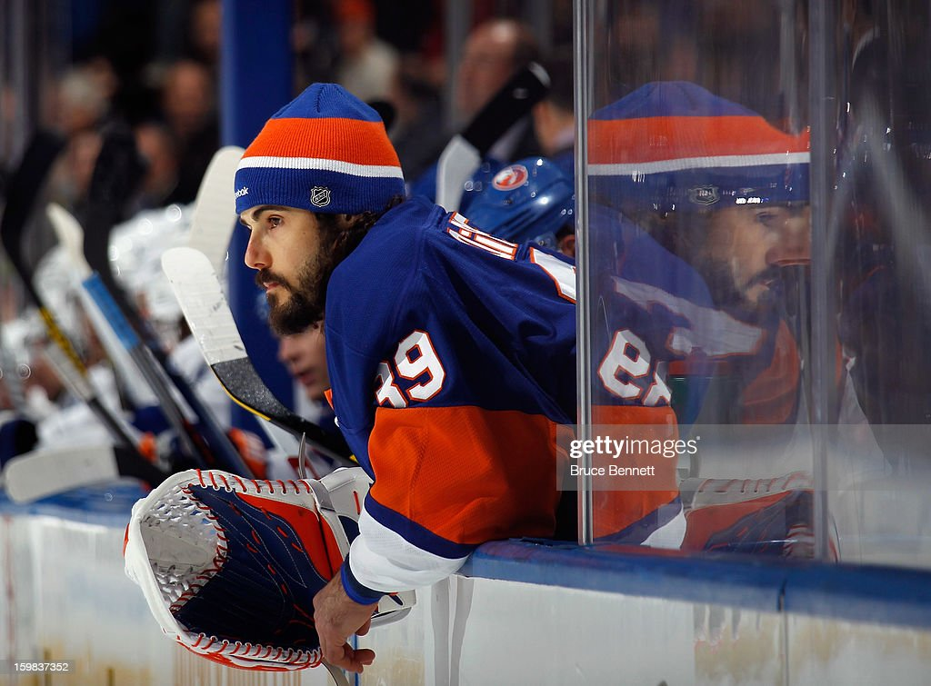 Rick DiPietro #39 of the New York Islanders watches the game against the Tampa Bay Lightning from the bench at the Nassau Veterans Memorial Coliseum on January 21, 2013 in Uniondale, New York.