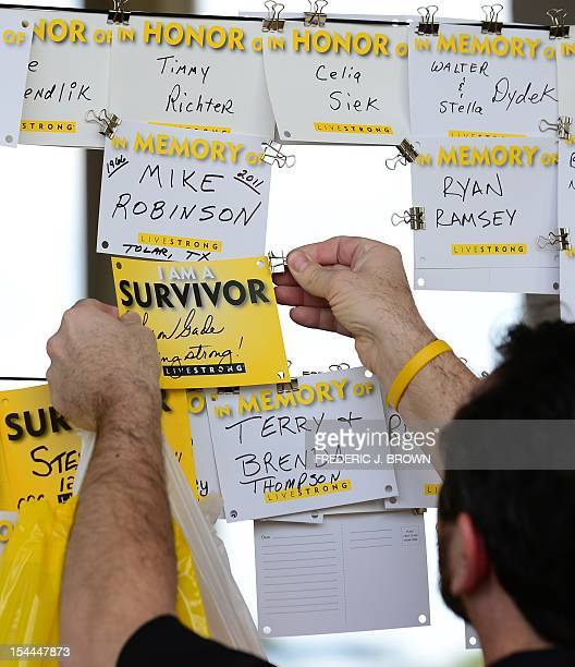 Rick Gade from Houston hangs a note in support of his cancer surviving wife Sharon at the venue a day ahead of the Team Livestrong Challenge...