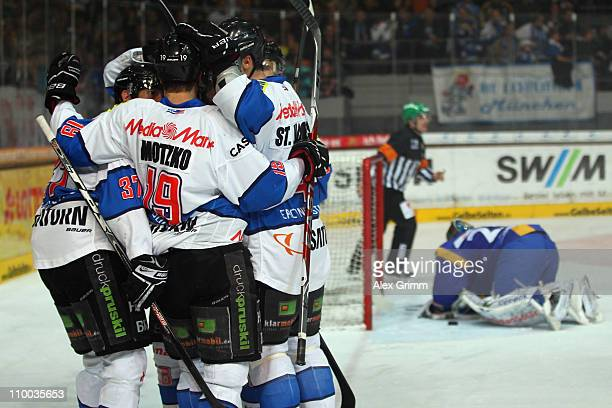 Rick Girard of Ingolstadt celebrates his team's third goal with team mates during the DEL match between EHC Muenchen and ERC Ingolstadt at Olympia...