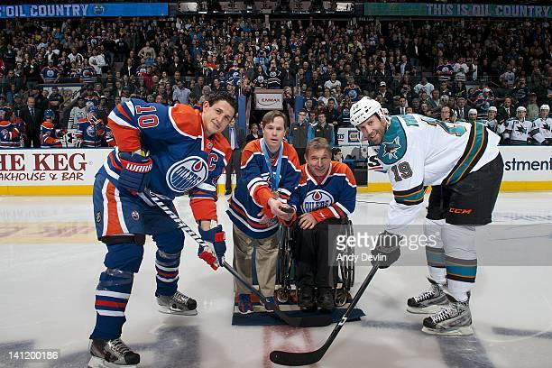 Rick Hansen and Joey Moss drop the ceremonial faceoff puck between Shawn Horcoff of the Edmonton Oilers and Joe Thornton of the San Jose Sharks at...