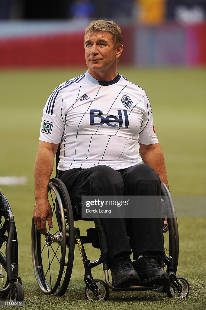 Rick Hansen smiles during the singing of the national anthem prior to the match between the Vancouver Whitecaps and Chicago Fire at B.C. Place on July 14, 2013 in Vancouver, British Columbia, Canada.