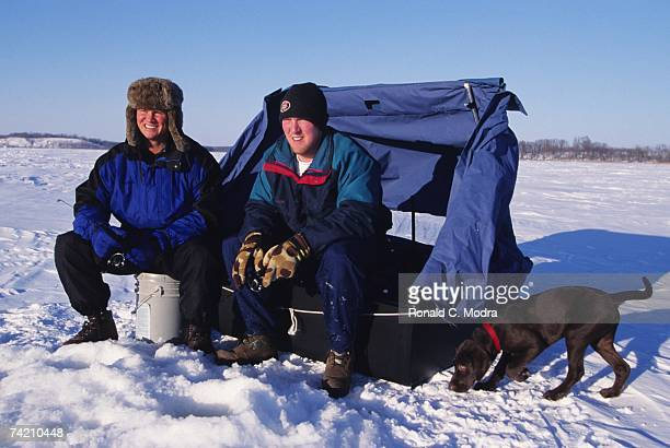 Rick Helling of the Texas Rangers and Darin Erstad of the Anaheim Angels ice fishing on Jaunary 6 1991 in Fargo North Dakota