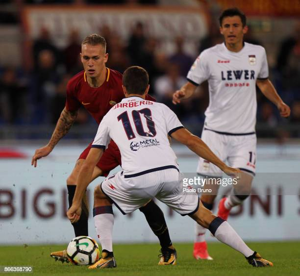 Rick Karsdorp of AS Roma competes for the ball with Andrea Barberis of FC Crotone during the Serie A match between AS Roma and FC Crotone at Stadio...